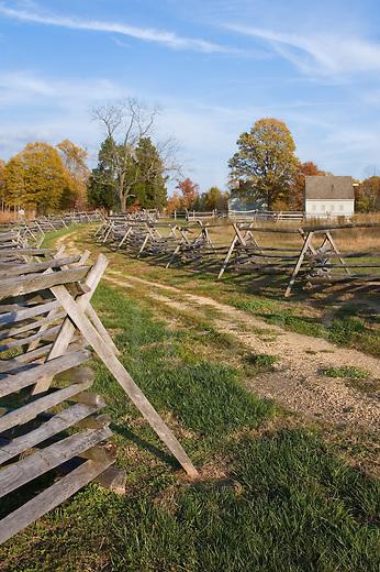 Traditional farming landscape, 1860's restored farm with split rail fenced road and fall colors in sunlight, Gaines Mill, American Civil War battlefield near Richmond, Virginia, VA, USA.