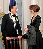 Yo-Yo Ma, one of the recipients of the 2011 Kennedy Center Honors, left, speaks with Capricia Penavic Marshall, Chief of Protocol of the United States, right, as he waits to pose for group photos following a dinner hosted by United States Secretary of State Hillary Rodham Clinton at the U.S. Department of State in Washington, D.C. on Saturday, December 3, 2011. The 2011 honorees are actress Meryl Streep, singer Neil Diamond, actress Barbara Cook, musician Yo-Yo Ma, and musician Sonny Rollins..Credit: Ron Sachs / CNP