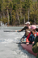 Writer Conor Mihell throws a paddle of ice shards into the air during an early spring canoe trip to Lady Evelyn-Smoothwater Provincial Park in Ontario Canada.