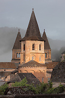 Towers of the Abbatiale Sainte-Foy de Conques or Abbey-church of Saint-Foy, Conques, Aveyron, Midi-Pyrenees, France, a Romanesque abbey church begun 1050 under abbot Odolric to house the remains of St Foy, a 4th century female martyr. The church is on the pilgrimage route to Santiago da Compostela, and is listed as a historic monument and a UNESCO World Heritage Site. Picture by Manuel Cohen