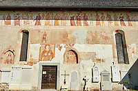 "Exterior of the Church of San Vigilio in Pinzolo and its fresco paintings ""Dance of Death"" painted by Simone Baschenis of Averaria in1539, Pinzolo, Trentino, Italy"
