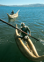 Aymara Indian fishermen in reed rafts called  balsa de totora, on Lake Titicaca, Bolivia