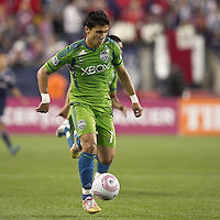 Seattle Sounders forward Fredy Montero (17) on the attack. In a Major League Soccer (MLS) match, the Seattle Sounders FC defeated the New England Revolution, 2-1, at Gillette Stadium on October 1, 2011.