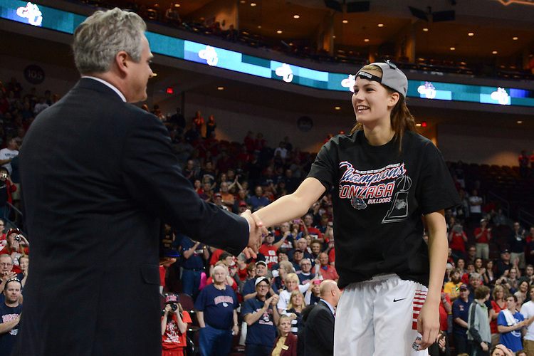 March 11, 2014; Las Vegas, NV, USA; Gonzaga Bulldogs forward Sunny Greinacher (14, right) shakes hands with WCC commissioner Jamie Zaninovich (left) for receiving the MVP trophy against the Brigham Young Cougars after the championship game of the WCC Basketball Championships at Orleans Arena.