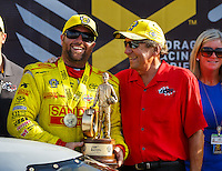 Sep 25, 2016; Madison, IL, USA; NHRA top fuel driver Shawn Langdon (left) celebrates with team owner Don Schumacher after winning the Midwest Nationals at Gateway Motorsports Park. Mandatory Credit: Mark J. Rebilas-USA TODAY Sports