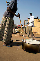 Africa, Sudan, Magwi County, Nimule, Southern Sudan - Preparing lunch at an orphanage in Nimule. The area is in the heart of Lord Resistance Amy territory. December 2005 © Stephen Blake Farrington