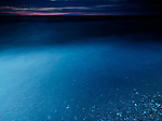 Clear dark blue glossy water of lake Huron at dusk, beautiful dramatic nature scenery, Pinery Provincial Park, Grand Bend, Ontario, Canada.