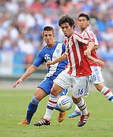 Paraguay forward Cristian Riveros (16) shields the ball against Guatemala midfielder Manuel Leon (15) Guatemala tied Paraguay 3-3 in a international friendly match at RFK Stadium, Wednesday August 15, 2012.