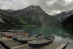 Rowing boats moored on wooden jetty on lake Visalpsee lake. Reutte district, Austrian, German border, Tyrol /Tirol Austria.