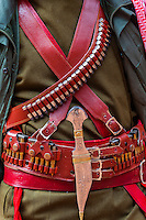 A Bedouin Desert Patrol policeman's gun belt and dagger at the Treasury monument (Al-Khazneh), Petra archaeological site (a UNESCO World Heritage site), Jordan.