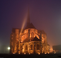 Apse of Saint Sauveur church, built 1198-1202, at Petit Andely in the early morning, illuminated in the mist, Les Andelys, Eure, Haute-Normandie, France. Picture by Manuel Cohen