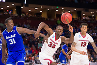 NWA Democrat-Gazette/J.T. WAMPLER Arkansas' Moses Kingsley (33) and Dustin Thomas chase a loose ball with Seton Hall's Angel Delgado Friday Mar. 17, 2017 during the first round of the NCAA Tournament at the Bon Secours Wellness Arena in Greenville, South Carolina. Arkansas won 77-71 and will advance to the second round, playing Sunday at the same location.