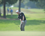 Golfer John Merrick chips on the 2nd hole at the PGA FedEx St. Jude Classic at TPC Southwind in Memphis, Tenn. on Thursday, June 9, 2011. Merrick shot a 4-under 66.
