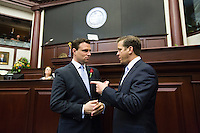 TALLAHASSEE, FLA. 3/4/14-House Speaker Will Weatherford, R-Wesley Chapel, left, talks with Lt. Gov. Carlos Lopez-Cantera, during a lull in the opening day of the legislative session, March 4, 2014 at the Capitol in Tallahassee.<br /> <br /> COLIN HACKLEY PHOTO