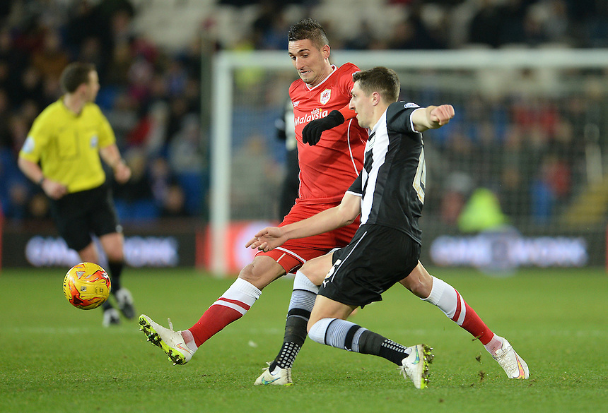 Watford's Craig Cathcart is put under pressure from Cardiff City's Federico Macheda<br /> <br /> Photographer Ian Cook/CameraSport<br /> <br /> Football - The Football League Sky Bet Championship - Cardiff City v Watford - Saturday 28th December - Cardiff City Stadium - Cardiff<br /> <br /> &copy; CameraSport - 43 Linden Ave. Countesthorpe. Leicester. England. LE8 5PG - Tel: +44 (0) 116 277 4147 - admin@camerasport.com - www.camerasport.com