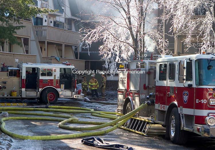 WATERBURY, CT- 11 FEB 06- 021107JT06- <br /> About 12 hours after the fire was reported, Waterbury firefighters continue to work on the blaze at the Bradley Gardens apartment complex on Sunday afternoon. The fire was reported at arund 2:30 a.m. and left one woman dead, nine injured, and more than 100 people forced out of their homes.<br /> <br /> Josalee Thrift Republican-American