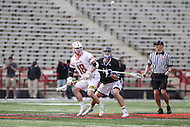 College Park, MD - February 18, 2017: Maryland Terrapins Austin Henningsen (18) fights for the faceoff during game between High Point and Maryland at  Capital One Field at Maryland Stadium in College Park, MD.  (Photo by Elliott Brown/Media Images International)