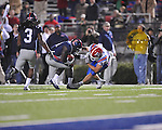 Ole Miss' Senquez Golson (21) intercepts a pass vs. Louisiana Tech and is tackled by Louisiana Tech's Hunter Lee (36) in Oxford, Miss. on Saturday, November 12, 2011.