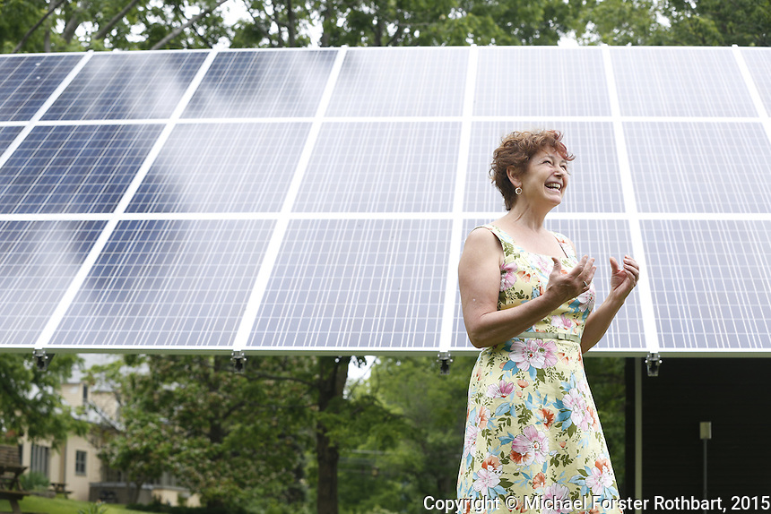 Rose Hilbert owns the Inn at Gothic Eves in Trumansburg, NY. In 2014 she installed 99 solar panels on her property, and is a member of Fossil Free Tompkins, a local environmental group in Ithaca, NY, working politically across Tompkins county to reduce dependence on fossil fuels. Their work includes political action against new fossil fuel infrastructure such as proposed conversion of the Cayuga Power Plant in Lansing to burn natural gas, the Crestwood Storage Facility in Seneca Lake and new pipelines. The group advocates instead for increase of renewable energy construction including the Black Oak Wind Farm in Enfield and solar installations. <br /> &copy; Michael Forster Rothbart Photography<br /> www.mfrphoto.com &bull; 607-267-4893<br /> 34 Spruce St, Oneonta, NY 13820<br /> 86 Three Mile Pond Rd, Vassalboro, ME 04989<br /> info@mfrphoto.com<br /> Photo by: Michael Forster Rothbart<br /> Date:  6/19/2015<br /> File#:  Canon &mdash; Canon EOS 5D Mark III digital camera frame B08570