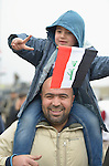 Supported by his father, a boy waves an Iraqi flag to celebrate the partial liberation of Mosul, Iraq, on January 27, 2017. The Iraqi army drove the Islamic State group out of the eastern part of the city in early in 2017. Despite the city's new freedom, Christians are unlikely to return soon due to concerns about their security in the largely Sunni Muslim community.