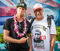 PIPELINE, Oahu/Hawaii (Saturday, December 14, 2013) - Mick Fanning (AUS) and photgrpaher Peter Joli Wilson (AUS). The final day of the Billabong Pipe Masters capped off the 2013 ASP World Championship Tour (WCT) season in fine style, with epic conditions providing the ideal backdrop for the crowning of Mick Fanning (AUS), 32, as the ASP World Champion. It also finalized the ASP Top 34 roster for 2014. Fanning finished third overall, defeated by Florence in their Semifinal.<br /> With tens of thousands packing the beach at Pipeline, and the gravitas of Slater&rsquo;s 56th elite tour victory apparent, the greatest athlete the sport has ever produced was emotional on the final day of 2013.<br /> <br /> Fanning&rsquo;s road to the 2013 ASP World Title was nothing short of spectacular on the final day of competition. Finding himself behind during both his Round 5 and Quarterfinals bouts, the iron-nerved Australian nailed huge Pipeline scores in both occasions to take the heat wins and his third world surfing crown.<br /> <br /> &ldquo;I&rsquo;ve never put myself in the same circles as Tom Curren and Andy Irons,&rdquo; Fanning said. &ldquo;Tom (Curren) is such an enigma and was so instrumental to injecting style into our sport. Andy (Irons)&hellip;what hasn&rsquo;t been said about Andy? He was such a legend and he was such a good friend. I&rsquo;m honored to be a part of this group. I was happy with one title and I was overwhelmed with two. With three? I don&rsquo;t have words for that.&rdquo;<br /> <br /> Today marked John John Florence&rsquo;s second Vans Triple Crown Title, but his runner-up in the final event forces him to hang on to his life-long dream of one day hoisting the Pipe Masters trophy. The youngster, who lives right here at Pipe, battled Slater with a series of exciting exchanges during the final 10 minutes, coming painfully close.Photo: joliphotos.com