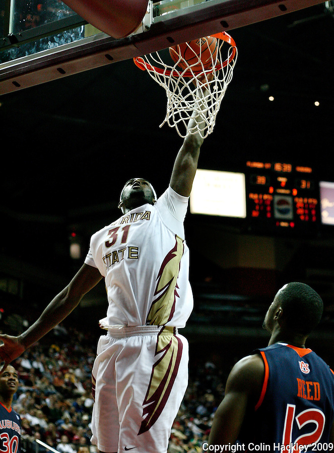TALLAHASSEE, FL 12/11/09-FSU-AU BB09 CH21-Florida State's Chris Singleton slams a shot over Auburn's DeWayne Reed during second half action Thursday at the Donald L. Tucker Center in Tallahassee. The Seminoles beat the Tigers 76-72...COLIN HACKLEY PHOTO
