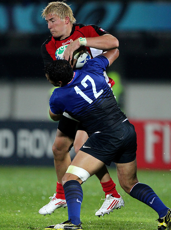 France's Maxime Mermoz tackles Canada's Dth van der Merwe in their Rugby World Cup pool match at McLean Park, Napier, New Zealand, Sunday, September 18, 2011. Credit:SNPA / John Cowpland