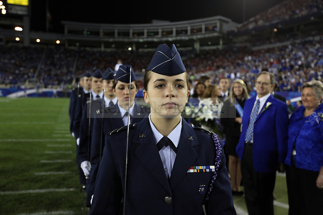 Christy Neely leads the Pershing Rifles onto the field during halftime of UK vs Georgia on Sat. Oct. 23, 2010. Photo by Britney McIntosh | Staff