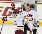 Austin Cangelosi (BC - 26) and Thatcher Demko (BC - 30) celebrate before exiting the ice. - The Boston College Eagles defeated the visiting Rensselaer Polytechnic Institute Engineers 7-2 on Sunday, October 13, 2013, at Kelley Rink in Conte Forum in Chestnut Hill, Massachusetts.