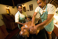 January 29th, 2008_Mararikulam, India_ A man receives an Ayurvedic massage in the Southern Indian resort hotel of Marari Beach.  Marari Beach is located in the Southern Indian state of Kerala and boasts eco-friendlyness as well as an Ayurvedic health center.  Photographer: Daniel J. Groshong/Tayo Photo Group