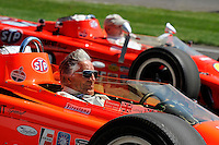 Mario Andretti and Parnelli Jones take a pair of 1968 STP Lotus Turbines for a spin before the start of the Indy 500.