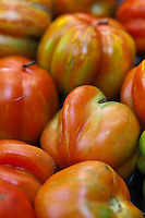 Heirloom tomatoes at a farmers market.