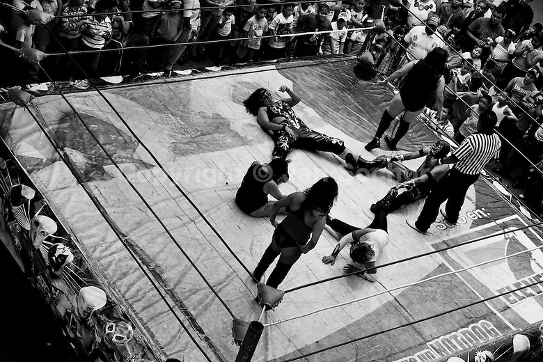 Female Lucha libre wrestlers fight during a mixed-sex performance at a local ...