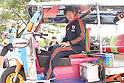 Kazuyoshi Miura (JPN),.JANUARY 2, 2012 - Futsal :.Kazuyoshi Miura of Japan sits in a tuk-tuk after the Japan national team training session in Nakhon Ratchasima, Thailand. (Photo by Kenzaburo Matsuoka/AFLO)..