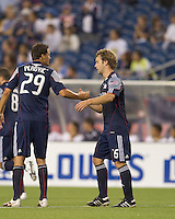 Goal scorer New England Revolution forward Zack Schilawski (15) acknowledges New England Revolution midfielder Marko Perovic (29) who assisted. The New England Revolution defeated Pumas UNAM in SuperLiga group play, 1-0, at Gillette Stadium on July 14, 2010.