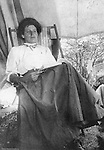 North East PA: View of Aunt Margaret Gray relaxing in a chair inside his tent while on vacation.  During the early 1900s, the Stewart family vacationed on Lake Erie near North East Pennsylvania. Since hotels and motels were non-existent, camping was the only viable option for a large number of vacationers.  Margaret Stewart Gray was Homer Stewart's sister.