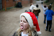Snow falls on Lucy Ashe Jones as she catches flakes on her tounge and black construction paper during recess, Dec. 18, 2009,  at Central Park School For Children in Durham.