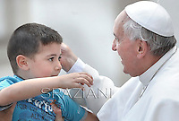 Pope Francis kisses a child from at the end of a canonisation mass,Pope Francis  the Canonization mass of Italian Antonio Primaldo and his companions, Colombian Laura Montoya Upegui and Mexican Maria Guadalupe Garcia Zavala in St.Peter's square at the Vatican  on May 12, 2013