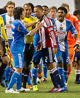 CARSON, CA - April 21, 2012: Philadelphia Union defender Gabriel Farfan (15) and Chivas USA defender Ryan Smith (22) during the Chivas USA vs Philadelphia Union match at the Home Depot Center in Carson, California. Final score Philadelphia Union 1, Chivas USA 0.