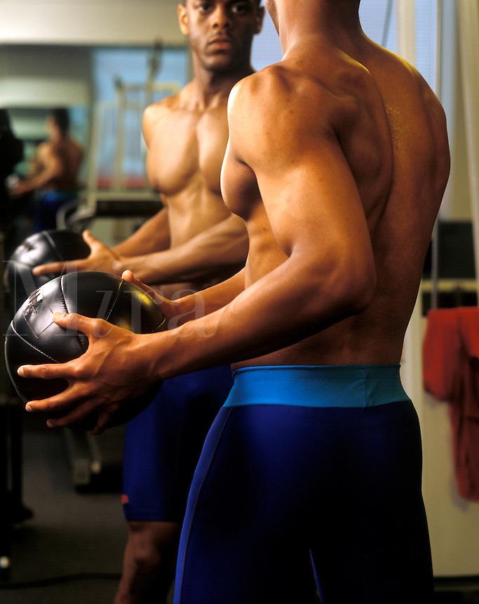Athlete rehabing with medicine ball.