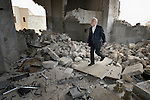 Father Emanuel Youkhana inspects the rubble of a Syriac Orthodox Church in Mosul, Iraq, on January 27, 2017. According to neighbors, the Islamic State group--which took over the city in 2014--used the building as a warehouse until the final weeks of their occupation, when they awarded the building to a contractor who began to demolish it in order to salvage the steel rebar in the walls. Although this portion of the city was liberated in early 2017, Christians are unlikely to return soon due to concerns about their security in the Sunni community.<br /> <br /> Youkhana is a priest in Duhok of the Holy Apostolic Catholic Assyrian Church of the East.