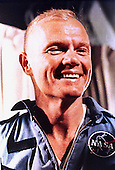 Astronaut John H. Glenn, Jr. smiles happily after his successful 3 orbit flight around the Earth on board the destroyer, USS NOA 21 minutes after landing near Grand Turk Island on February 20, 1962..Credit: NASA via CNP