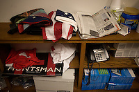 An American flag and campaign materials rest on shelves at the Jon Huntsman New Hampshire campaign headquarters in Manchester, New Hampshire, on Jan. 7, 2012.  Huntsman is seeking the 2012 Republican presidential nomination.