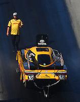 Jun 17, 2016; Bristol, TN, USA; Crew member Matt Bynum with NHRA funny car driver Del Worsham during qualifying for the Thunder Valley Nationals at Bristol Dragway. Mandatory Credit: Mark J. Rebilas-USA TODAY Sports