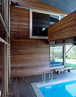 The house is anchored around the pool and when in the pool there is the sensation of swimming right into the house