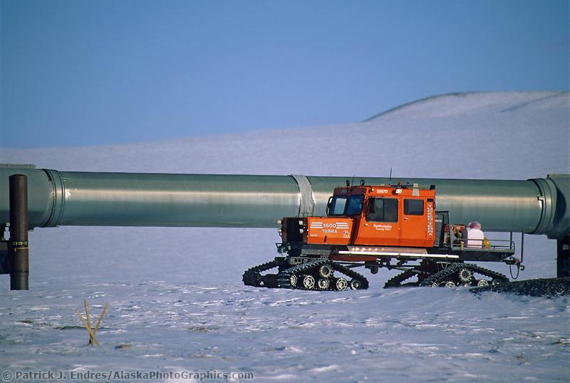 Snow track vehicles travels along the Trans Alaska Oil Pipeline
