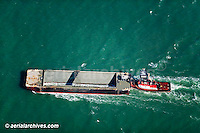 aerial photograph tug boat pushing an empty barge in San Francisco bay
