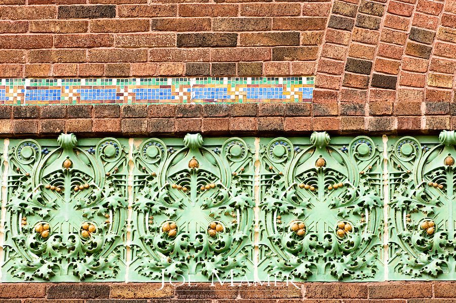 "Exterior terra cotta detail of the National Farmers' Bank of Owatonna, Minnesota. The bank was built in 1908. Designed by Louis Sullivan with decorative elements by George Elmslie it was the first of Sullivan's ""jewel boxes"". The exterior windows were designed by Louis J. Millet..."