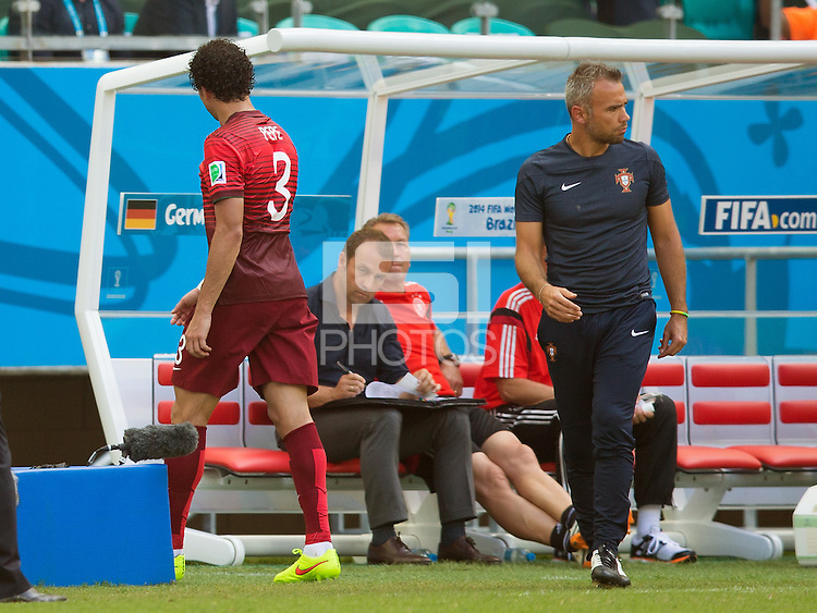 Pepe walks past Portugal manager Paulo Bento after being sent off for head butting Thomas Muller of Germany
