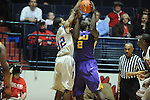 "LSU's Johnny O'Bryant III (2) is fouled by Ole Miss' Jarvis Summers (32) at the C.M. ""Tad"" Smith Coliseum in Oxford, Miss. on Saturday, February 25, 2012. (AP Photo/Oxford Eagle, Bruce Newman).."